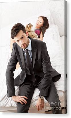 Couple Canvas Print - Man In Suit Sitting In Bed With His Wife And A Cat by Wolfgang Steiner