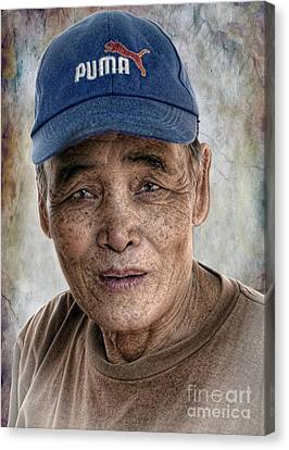 Man In The Cap Canvas Print