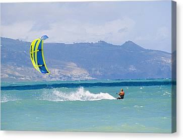 Man Kiteboarding In Turquoise Water Canvas Print by Mark Cosslett