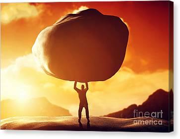 Man Lifting A Huge Rock Canvas Print by Michal Bednarek
