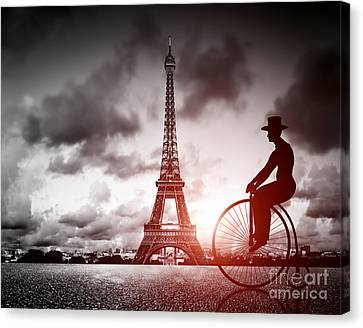 Man On Retro Bicycle Next To Effel Tower Canvas Print by Michal Bednarek