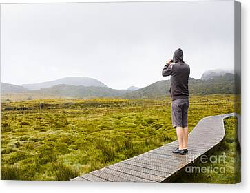 Man On Trekking Holiday Taking Phone Photograph Canvas Print by Jorgo Photography - Wall Art Gallery