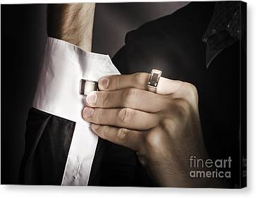 Man Putting Stylish Cuff Links On His Shirt Canvas Print by Jorgo Photography - Wall Art Gallery