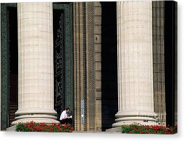 Man Reading A Book Beside The Columns Of La Madeleine Church In Paris Canvas Print by Sami Sarkis