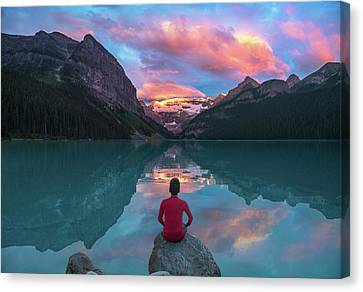 Canvas Print featuring the photograph Man Sit On Rock Watching Lake Louise Morning Clouds With Reflect by William Lee