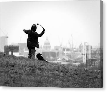 Man Throwing Ball To London Canvas Print by Emre Zengin