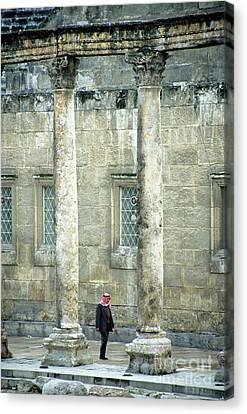 Man Walking Between Columns At The Roman Theatre Canvas Print by Sami Sarkis