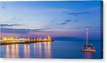 Mandraki Harbour At Twilight Canvas Print by Werner Dieterich
