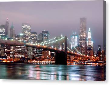 Manhattan And Brooklyn Bridge Under Fog. Canvas Print by Shobeir Ansari