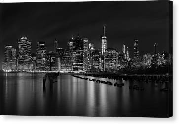 Black Canvas Print - Manhattan At Night In Black And White by Andres Leon