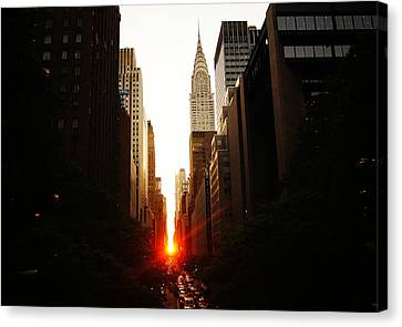 Manhattanhenge Sunset Over The Heart Of New York City Canvas Print by Vivienne Gucwa