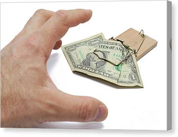 Man's Hand About To Catch Dollar Banknote On Mousetrap Canvas Print by Sami Sarkis