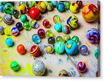 Marbles On Old Table Canvas Print