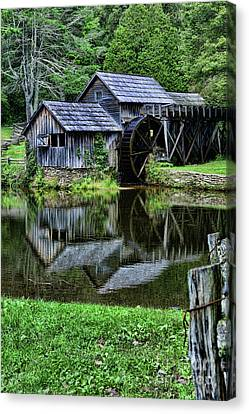 Marby Mill Reflection Canvas Print by Paul Ward