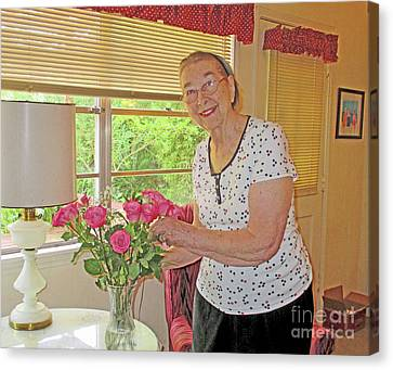Marion Loves Roses Canvas Print by Fred Jinkins
