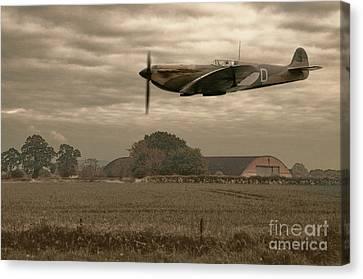 Mark 1 Supermarine Spitfire Flying Past Hanger Canvas Print by Amanda Elwell