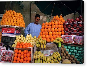 Market Vendor Selling Fruit In A Bazaar Canvas Print by Sami Sarkis