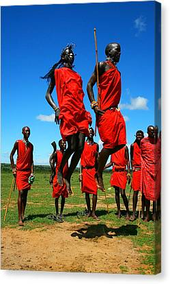 African Traditional Dances Canvas Print - Masai Warrior Dancing Traditional Dance by Anna Om