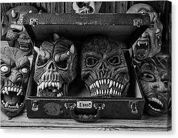 Masks In Suitcase Black And White Canvas Print