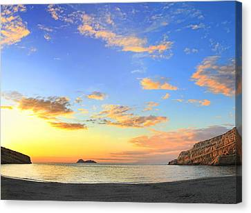 Matala Bay Sunset Canvas Print by Paul Cowan