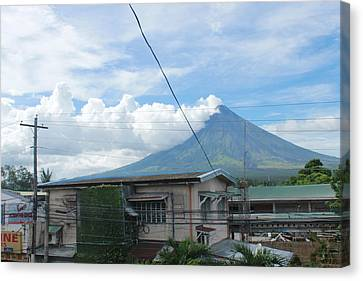 Mayon In-front Of My House Canvas Print by Manuel Cadag