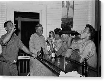 Men Drinking Beer At The Bar Canvas Print by Everett