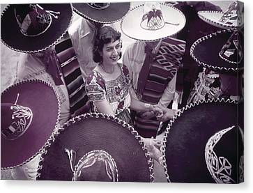 Men In Sombreros Surround A Woman Canvas Print by B. Anthony Stewart