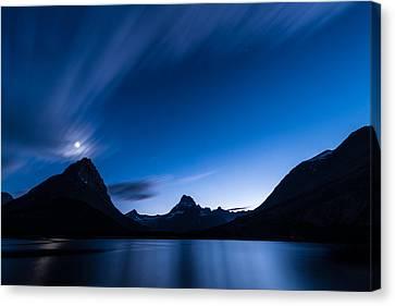 Midnight Over Glacier National Park Canvas Print by Steve Gadomski