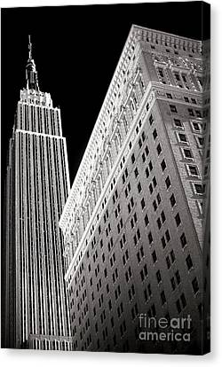 Canvas Print featuring the photograph Midtown Empire by John Rizzuto