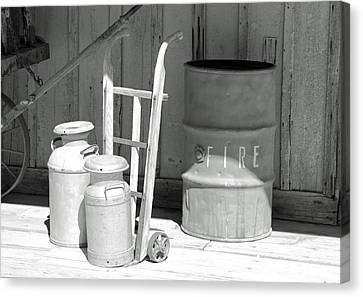 Milk Cans And Fire Barrel Canvas Print by Troy Montemayor