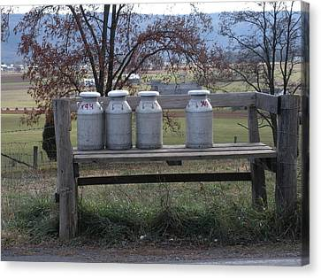 Canvas Print featuring the photograph Milk Cans Waiting For Pickup by Jeanette Oberholtzer