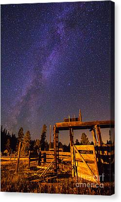 Milky Way Over Old Corral Canvas Print by John R. Foster