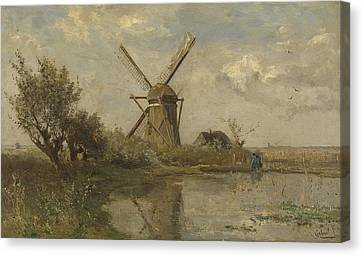 Mill In A Puddle Canvas Print by Paul Gabriel