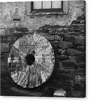 Mill Stone Canvas Print by Val Arie