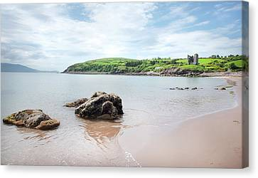 Minard Beach And Castle Canvas Print by James Brown