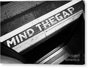 Mind The Gap Between Platform And Train At London Underground Station England United Kingdom Uk Canvas Print