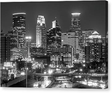 Canvas Print featuring the photograph Minneapolis City Skyline At Night by Jim Hughes