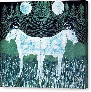 Mirror Image Goats In Moonlight Canvas Print by Carol Law Conklin