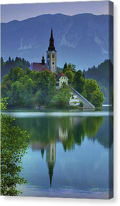 Mirrored Church At Sunrise Canvas Print by Don Wolf
