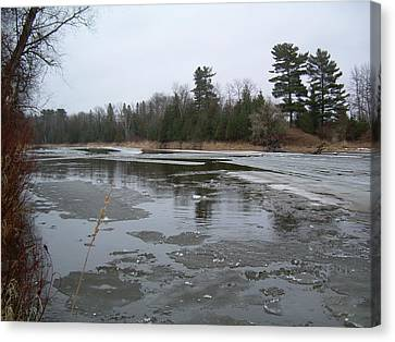 Canvas Print featuring the photograph Mississippi River Ice Flow by Kent Lorentzen