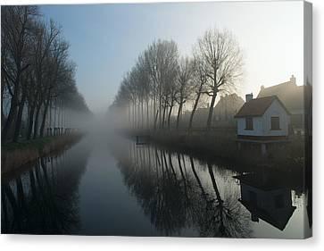 Mist Across The Canal Canvas Print by Elisabeth Wehrmann