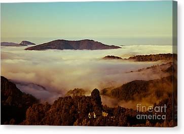 Mist Over Apuseni Canvas Print by Gabriela Insuratelu