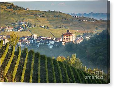 Misty Dawn Over Barolo Canvas Print by Brian Jannsen