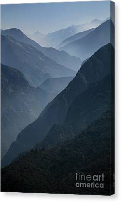 Misty Peaks Canvas Print by Timothy Johnson
