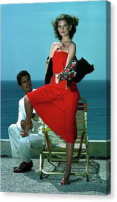 Model Wearing A Red Dress Canvas Print by Guy Le Baube