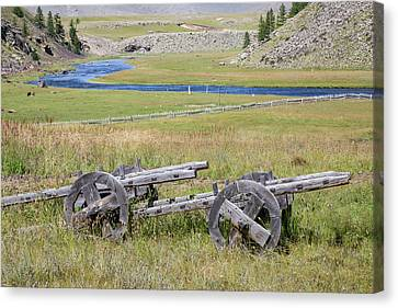 Canvas Print featuring the photograph Mongolian Ox Carts by Hitendra SINKAR