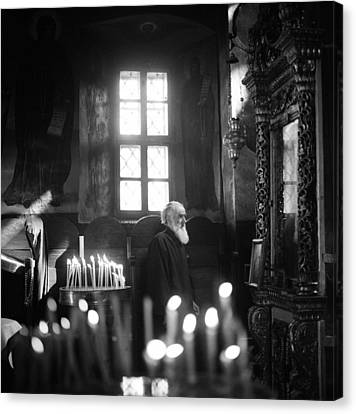 Monk And Candles Canvas Print by Emanuel Tanjala