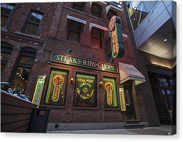 Canvas Print featuring the photograph Monroe St Steakhouse by Nicholas Grunas