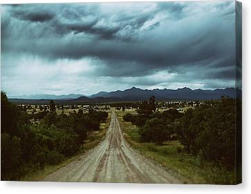 Monsoons From The Meadows Canvas Print by Jason Coward