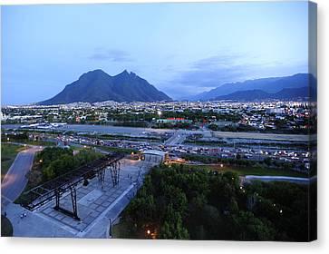 Monterrey At Dusk With Cerro De La Canvas Print by Raul Touzon